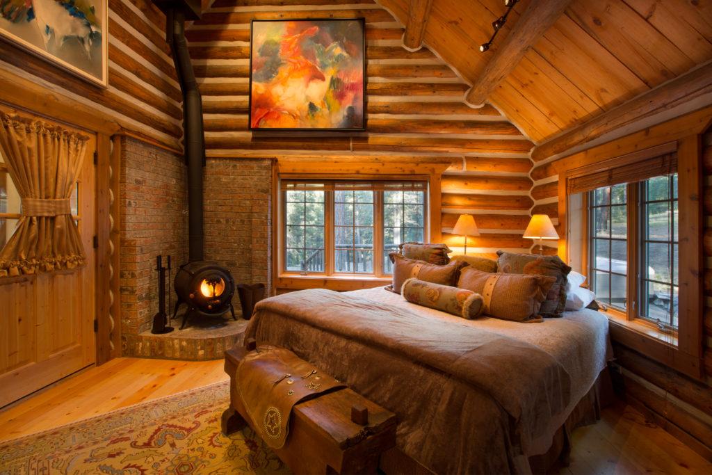 A cabin bedroom at Triple Creek Ranch