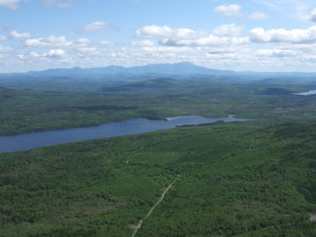 Aerial shot of Second RoachPond, in the Maine Woods Initiative. Photo by Marc Chalufour
