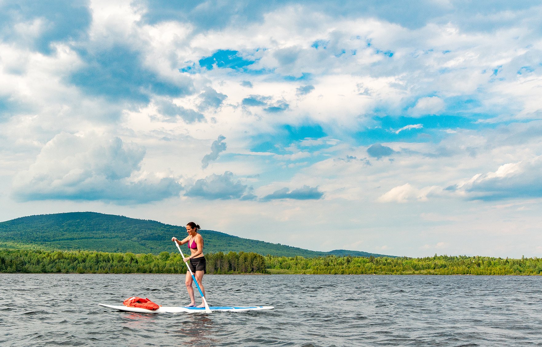 A female paddle boarder on Second Roach Pond